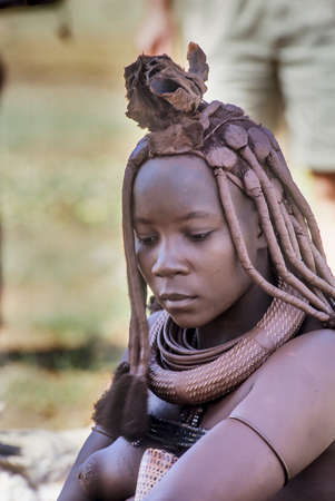 May 15, 2005. portrait of unidentified Himba woman with the traditional hairstyle, necklace and the typical ochre tinted skin. Epupa Falls, Kaokoland or Kunene Province, Namibia, Africa