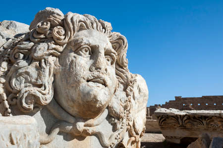 rchaeological site of Leptis Magna, Libya - 10/30/2006: The head of Medusa in the Forum of Severe in the ancient Roman city of Leptis Magna Editoriali