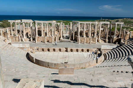 Archaeological site of Leptis Magna, Libya - 10/30/2006: Tourists at the ancient theater in the ancient Roman city of Leptis Magna. Editorial