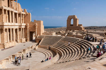 Archaeological Site of Sabratha, Libya - 10/31/2006: Tourists at the Theatre of the ancient Phoenician city of Sabratha