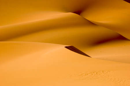 The orange dunes of the libyan Sahara desert