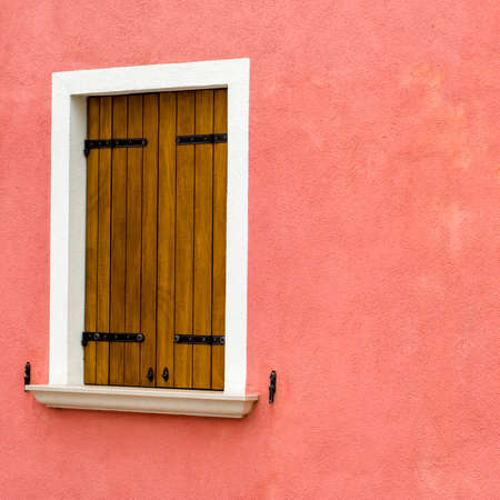 A window of one of the characteristic colored houses of Burano (Venice)