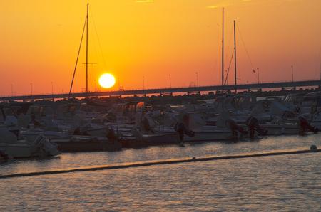 Summer sunset port of Vada, municipality of Rosignano Marittimo, Livorno, Italy Stock Photo - 110218030
