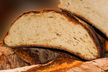 superimposed: Photo horizontal composition of a slice of fresh bread in the foreground sliced