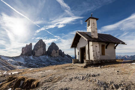 typical: Three peaks of Lavaredo and typical church