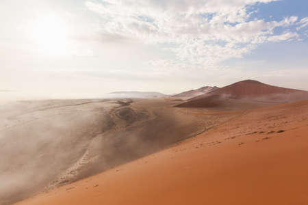 retreats: The fog retreats in the desert of Namibia