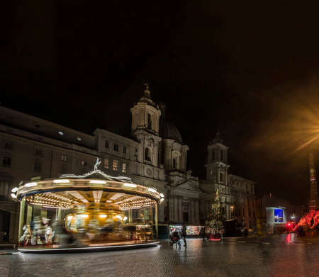 roman magic atmosphere by night at Navona square with carousel