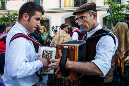 folk heritage: QUARTU SE, ITALY - September 15, 2012: Parade of the Wine Festival 2012 - Sardinia Editorial