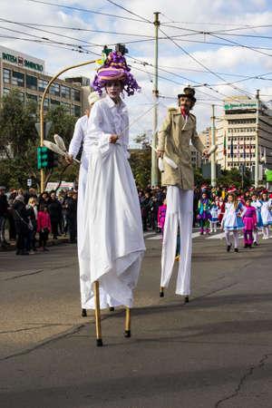 CAGLIARI, ITALY - DECEMBER 8, 2017: Village and parade of Santa Claus, Viale Bonaria - Sardinia (waders, jugglers and Disney mascot)