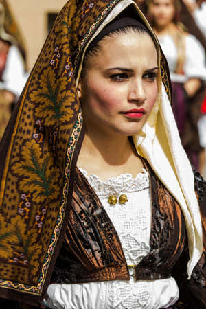 CAGLIARI, ITALY - MAY 1, 2014: 358 Religious Procession of SantEfisio, portrait of a beautiful woman wearing a traditional Sardinian costume - Sardinia