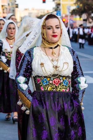 QUARTU S.E., ITALIA - SETTEMBRE 17, 2016: Sfilata di costumi sardi e carri per la sagra delluva in onore dei festeggiamenti di SantElena. - Sardegna