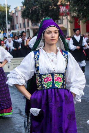 QUARTU SE, ITALY - SEPTEMBER 16, 2017: Parade of Sardinian costumes and carts for the grape festival in honor of the celebrations of Saint Helena. - Sardinia Редакционное