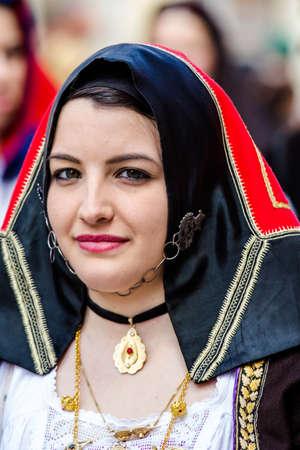 CAGLIARI, ITALY - MAY 1, 2016: 360 Feast of SantEfisio, portrait of a beautiful woman wearing a traditional Sardinian costume - Sardinia