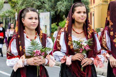 SELARGIUS, ITALY - SEPTEMBER 13, 2015: Ancient Selargino wedding, parade of traditional Sardinian costumes - Sardinia