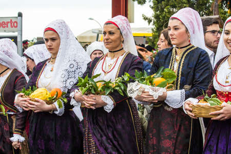 MURAVERA, ITALY - APRIL 2, 2017: 45th Citrus Festival, parade of Sardinian traditional costumes - Sardinia