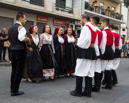 QUARTU SE, ITALY - SEPTEMBER 21, 2014: Parade of Sardinian costumes and carts for the grape festival in honor of the festivities of SantElena - Sardinia