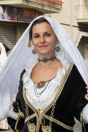SELARGIUS, ITALY - SEPTEMBER 8, 2013: Old Selargino wedding, parade of Sardinian traditional costumes - Sardinia Editorial