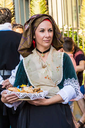 SELARGIUS, ITALY - SEPTEMBER 14, 2014: Ancient Selargino wedding, parade of traditional Sardinian costumes - Sardinia