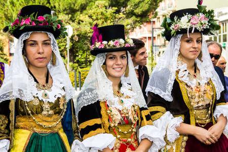 SELARGIUS, ITALY - SEPTEMBER 8, 2013: Old Selargino wedding, parade of the folk group on scrignu de Campidanu - Sardinia