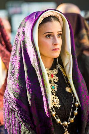QUARTU SE, ITALY - SEPTEMBER 13, 2017: Procession of Saint Helena, portrait of a beautiful girl wearing a traditional Sardinian costume - Sardinia