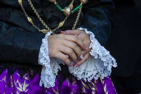 QUARTU SE, ITALY - SEPTEMBER 13, 2017: Procession of Saint Helena detail of a traditional Sardinian costume - Sardinia Imagens