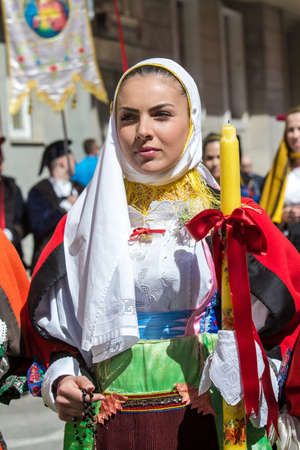 CAGLIARI, ITALY - MAY 1, 2015: 359 Religious Procession of SantEfisio, portrait of a beautiful woman wearing a traditional Sardinian costume - Sardinia