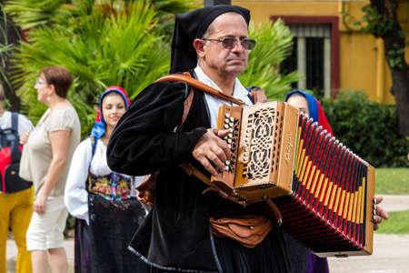 SELARGIUS, ITALY - SEPTEMBER 13, 2015: Ancient Selargino wedding, musician parading in traditional Sardinian costume - Sardinia