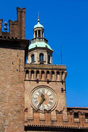 BOLOGNA, ITALY - JULY 22, 2017: Piazza Maggiore, clock tower of the Palazzo dAccursio or Comunale which is currently the town hall - Emilia Romagna