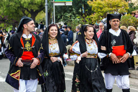 MURAVERA, ITALY - APRIL 2, 2017: 45th Citrus Festival - parade of the Don Milani folk group from Dorgali - Sardinia