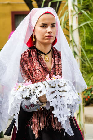 SELARGIUS, ITALY - SEPTEMBER 13, 2015: Ancient Selargino wedding, portrait of a beautiful woman from the folk group Maria Carta of Gonnesa - Sardinia