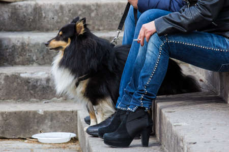 Woman sitting with a dog