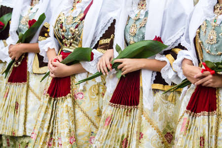 SELARGIUS, ITALY - SEPTEMBER 10, 2017: 57th Edition of the ancient Selargino wedding, detail of traditional Sardinian costumes - Sardinia Editorial