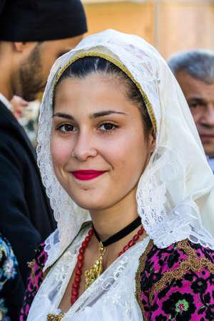 QUARTU SE, ITALY - SEPTEMBER 17, 2016: Parade of Sardinian costumes and carts for the grape festival in honor of the celebrations of Saint Helena. - Sardinia
