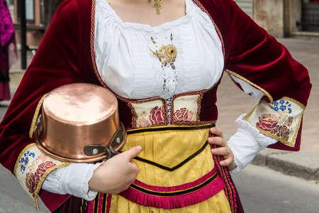 QUARTU SE, ITALY - SEPTEMBER 15, 2013: Grape festival, in honor of the celebrations of SantElena, detail of a traditional Sardinian costume of the Isili folk group - Sardinia