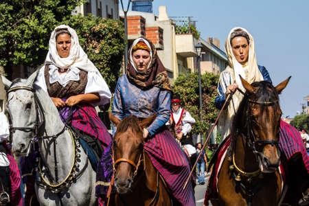 SELARGIUS, ITALY - SEPTEMBER 14, 2014: Ancient Selargino wedding, parade in traditional Sardinian costume - Sardinia Editorial