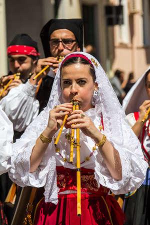 CAGLIARI, ITALY - MAY 1, 2015: 359 Religious Procession of SantEfisio, launeddas musicians parading in traditional Sardinian costume - Sardinia