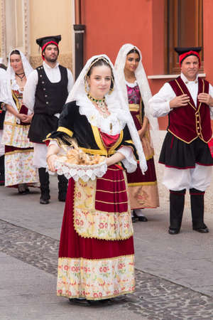 QUARTU SE, ITALY - SEPTEMBER 21, 2014: Parade of Sardinian costumes and carts for the grape festival in honor of the festivities of Sant'Elena - Sardinia