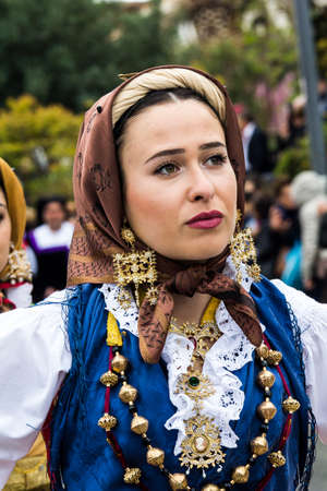 MURAVERA, ITALY - APRIL 2, 2017: 45th Citrus Festival, portrait of a beautiful woman wearing a traditional Sardinian costume - Sardinia