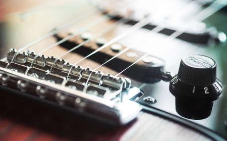 pickups: electric guitar closeup of bridge, volume and pickups Stock Photo