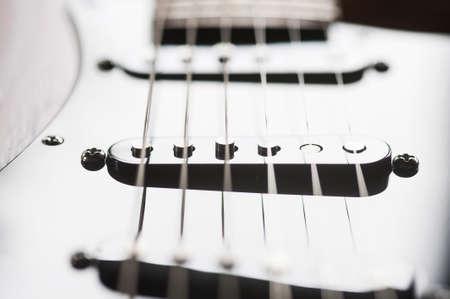 pickups: closeup of pickups on an electric guitar