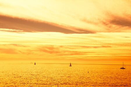 rise and shine: Sailing during sunset Stock Photo