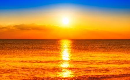 Sunset on the beach Standard-Bild
