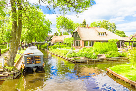 Typical Dutch houses and gardens in Giethoorn, The Netherlands