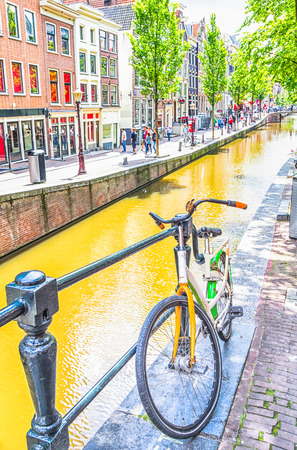 Bicycle and canal in Amsterdam photo