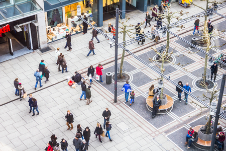 aerial: People walking along the Zeil street in Frankfurt, Germany