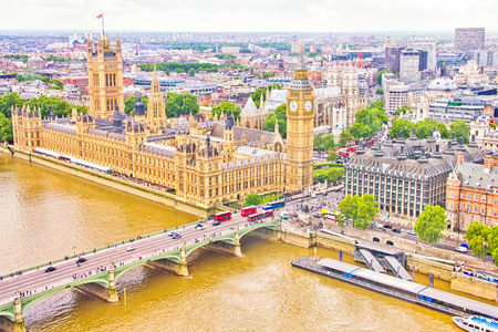 Aerial view of the Big Ben, the Parliament and the Thames river photo