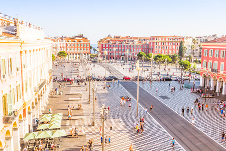 Tourists walking in the Place Massena in Nice, France