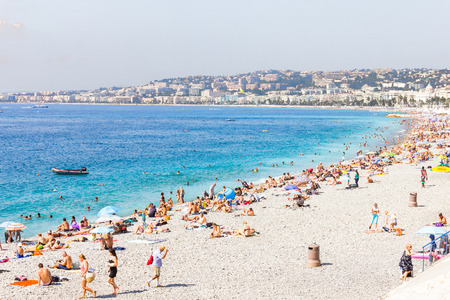 cote d'azur: Tourists in the beach in Nice, France