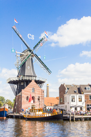 Typical windmill and medieval architecture in Haarlem, The Netherlands Editorial
