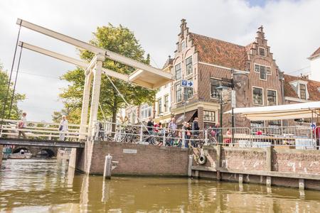 drawbridge: People walking on the famous drawbridge in Alkmaar, The Netherlands